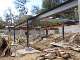 we chose to use steel framing to elevate a slab over the land because of the seasonal creek that would otherwise cause issues in a crawle