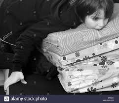 black kids watching tv. child kid boy children kids watching tv television lying on bed funny hands serious thinking male age 9 years alone caucasian black tv