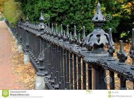 wrought iron fence brick. Beautiful Detail Of Black Wrought Iron Fence And Brick Walkway