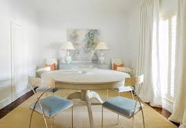 extra large round dining table and brass chairs with blue velvet seats