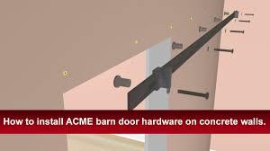 how to install renin s barn door hardware into concrete walls