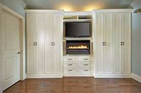 Antique White Wall Unit contemporary-bedroom