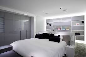 Delightful White And Grey Tones Fill This Bedroom, Contrasted Only By The Black Accent  Pillows And