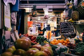photo essay spanish food markets at the heart of two cities nu 1 a w arranges fruit juice as la boqueria opens at 8 in the morning