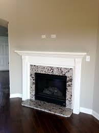 gas fireplace with granite surround and painted mantle