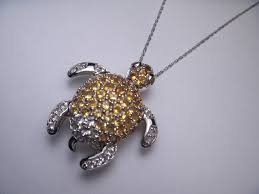 14k white gold citrine and white topaz turtle necklace pendant the lovely piece features numerous natural round citrines and white topaz with a total
