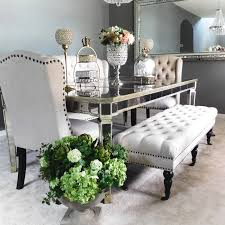 monique glamour s zgallerie inspired formal dining room mixtures of silver gold and brushed nickel along with neutral tufted seating allow this formal