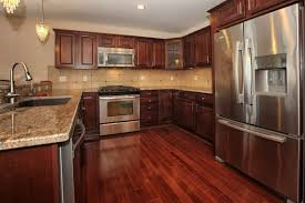laminate kitchen floor with cherry kitchen cabinet and granite countertop full size