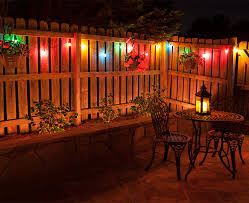 backyard party lighting ideas. colorful globe patio lights illuminate a backyard dinner party plus more great outdoor lighting ideas n