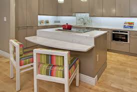 a kirkwood mo condo owner wanted to use existing dining room chairs with her new island so the granite countertop surrounding the convection cooktop drops
