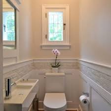 example of a small classic gray tile and matchstick medium tone wood floor powder room traditional ideas e56 room