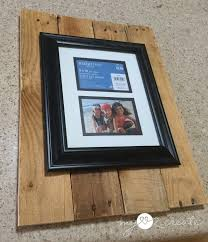 measuring an 8x10 frame on pallet wood