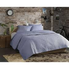 save the planet and provide a stylish update to your home with the madison park eco weave johnathan quilt set this navy and white stripe has