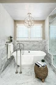 light over bathtub chandelier hanging above