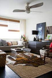 cowhide rug living room ideas 10 tips to help you master layering rugs