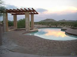pleasure island fiberglass pool shape with stone pergola and sunset