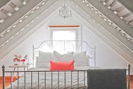 Stunning attic bathroom makeover ideas budget Loft Conversion Crisp White Bedding And Coat Of Eggshell Paint On The Wood Beams Keep This Intimate Fieras From Boardinghouse To Bohemian Dream Home Western Living Magazine