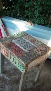 pallet table covered in license plates upcycle recycle salvage repurpose diy for ideas and goods shop at estate resale redesign bonita springs antique unique pallet ideas