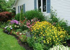 Small Picture Cottage Garden Designs We Love Black eyed susan Hollyhock and