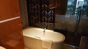 oasia hotel downtown singapore by far east hospitality club room s bathroom with rain shower