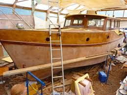 a wooden boat being built inside a shed at premier marinas dartmouth