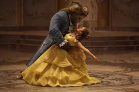 this image released by disney shows dan stevens as the beast left and emma watson as belle in a live action adaptation of the animated classic
