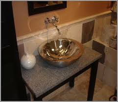 bathroom vessel sinks and faucets. small round metal vessel sink in gold tone color a wall mount steel faucet bathroom sinks and faucets v