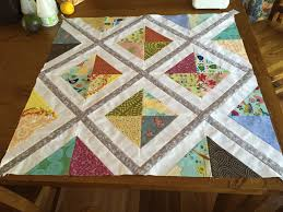Tutorial: Diagonal Quilt Sashing – Simple Crafty Life & Finished quilt top with grey diagonal sashing Adamdwight.com