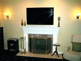 hanging tv on stone fireplace ing mount into