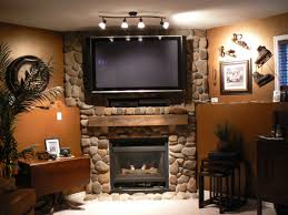 corner wall mount for flat screen tv with above stone fireplace design ideas