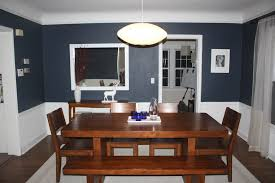 It has a wooden dining set illuminated by three glass pendant lights. Privileges Of Dining Room With Blue Walls Wall Decor Ideas For Bedroom Decoration Living Kitchen Bathroom Laundry Cartoon Elegant Rooms Modern Apppie Org