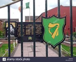 belfast falls rd republican peace garden gates with eire harp symbol