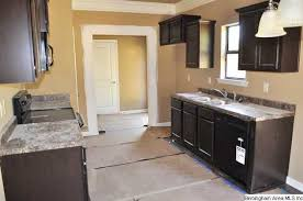 Any Cook Will Love This Kitchen With Dark Cabinets A Pantry, And Laminate  Flooring.