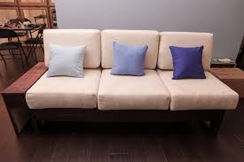 the completed couch with accent pillows and stained wood