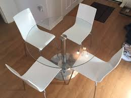 john lewis enzo 4 seater round dining table and white chairs in