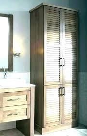 linen cabinet corner wood narrow tall o cabinets throughout bathroom closet floor ikea storage free s bathroom space saver great cabinet