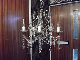 bronze coloured 5 arm chandelier with glass droplets