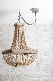 how to hang a plug in chandelier gorgeous wood bead chandelier in front of a