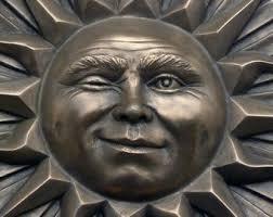 ceramic sun face wall art