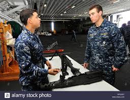 U S Navy Gunners Mate 3rd Class Lupe Ramos Left Teaches Stock
