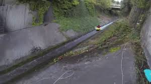drainage ditch crazy man goes kayaking down a drainage ditch at high speed for