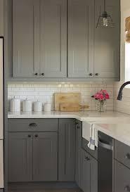 grey kitchen cabinets with backsplash