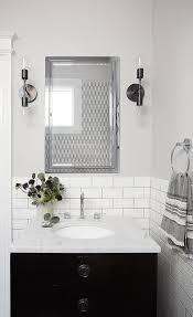 black and gray powder room with french vanity