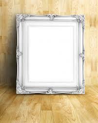 blank vintage white victorian style picture frame on parquet premium photo