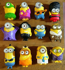 rows of mcdonald s minion happy meal toys on a wooden background ebay user bob the spy