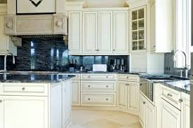kitchen backsplash ideas for white cabinets black countertops this lovely kitchen uses the same beautiful granite