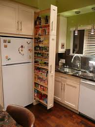 Diy Kitchen Cabinet Plans Stunning The Narrow Cabinet Beside The Fridge Pulls Out To Reveal A Spice