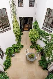 the buildings had an unusual formation in that they were each shaped around a courtyard garden in the centre