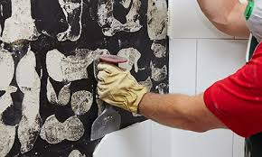 using a brick bolster and hammer to remove tiles