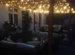 outdoor fairy lighting. warm white fairy lights on garden pergola at nighttime outdoor lighting h